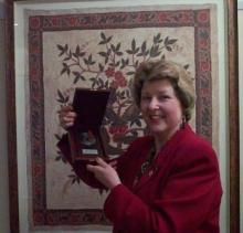 Lisa, President of VILTA, with award from the Indonesian Consulate